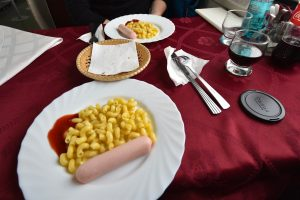 Macaroni and sausage as third course in Trans-Siberian railway restaurant.