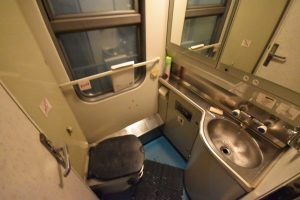 One of the two toilets in the first class wagon.