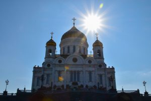 Sun behind Church of Christ the Saviour in Moscow.