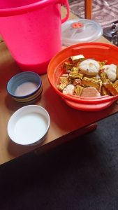 Mare's milk, salty milk tea and sweets served by nomadic family in Mongolia.