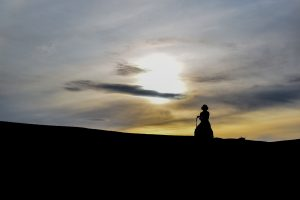 Our guide taking it slow on his horse in the Mongolian steppes.